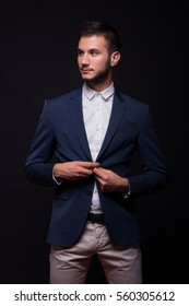 young adult man 20s model, buttoning jacket, suit elegant, black background
