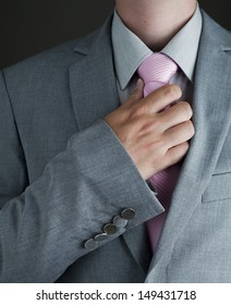 Young Adult Man in Gray Suit and Pink Tie