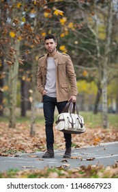 Young adult man handsome walking in the wood, winter autumn day