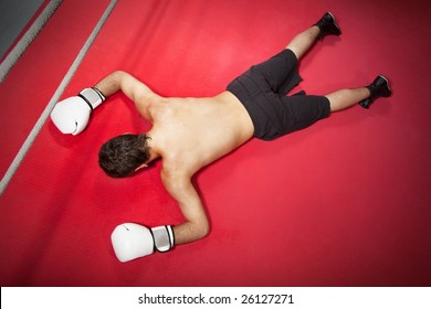 Young adult man knocked down. Copy space