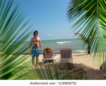 young adult man relaxing on beach