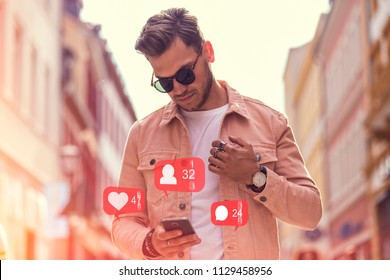 Young Adult Man Using Social Media on Smartphone on The Street at Summer Time - Like, Follower, Comment Icons in Speech Bubble with Counter