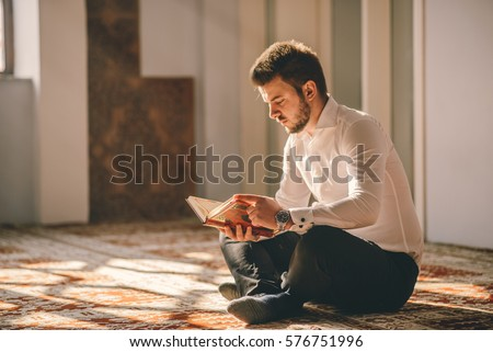 Young adult Muslim reading