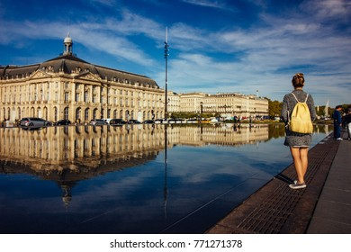 Young adult next to the water mirror in Bordeaux, France