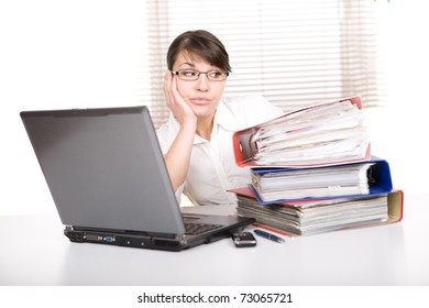 young adult over-worked woman at desk
