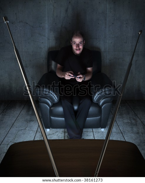 young adult playing video games in a grungy and dark room only lightened by the TV screen
