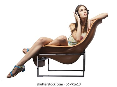 Young adult sitting the chair listening to music
