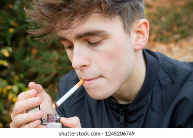Young adult smoking outside
