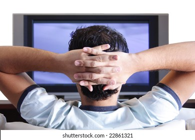 A young adult watching TV.