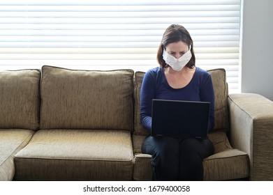 Young adult woman diagnosed as infected in Coronavirus in a self home isolation lock down quarantine working from home. Real people. Copy space