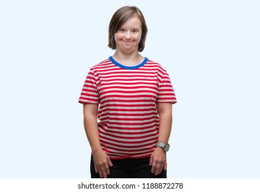 Young adult woman with down syndrome over isolated background with a happy and cool smile on face. Lucky person.