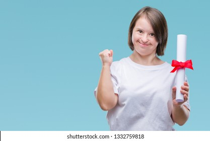 Young adult woman with down syndrome holding degree over isolated background screaming proud and celebrating victory and success very excited, cheering emotion