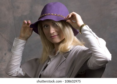 young adult woman in hat and coat