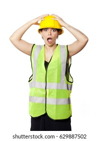 Young adult woman in her mid 20s wearing reflective yellow safety helmet and safety vest, raising her hands on her hat and giving the camera a bewildered expression. Isolated on white background.