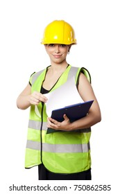 Young adult woman in her mid 20s wearing reflective yellow safety helmet and safety vest, giving the camera a smile while holding a clipboard. Isolated on white background.