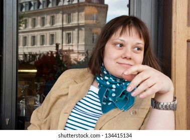 Young adult woman in street cafe in Paris, France
