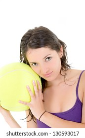young adult woman with tennis ball. over white background
