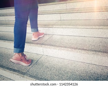 Young adult woman walking up the stair with light for  future, go to the target , step up concept