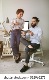 Young adults hipster male and female working at home with coffee
