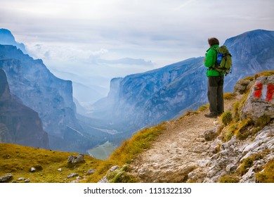 Young adventurer standing on a cliff