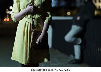 Young afraid woman walking alone at night