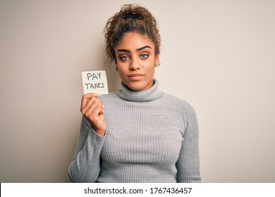 Young african american afro girl holding reminder paper with pay taxes message with a confident expression on smart face thinking serious
