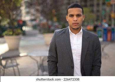 Young African American black Latino man serious face portrait