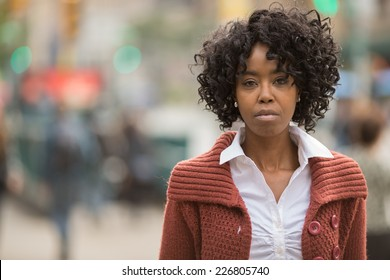 Young African American black woman in New York City serious face portrait
