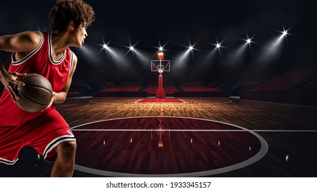 Young African American boy with basketball in the middle of the stadium ready to go to the basket