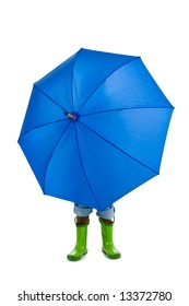 A young African American boy behind a big blue umbrella. Isolated on a white background.