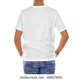 Young African American boy in blank white t-shirt standing on white background
