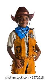 Young African American boy dressed as a cowboy. Isolated on a white background.