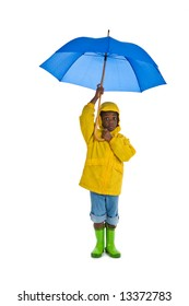 A young African American boy wearing a yellow rain slicker and carrying a blue umbrella. Isolated on a white background.