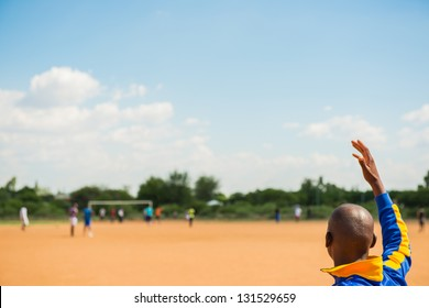 Young african american boys playing european football outdoor