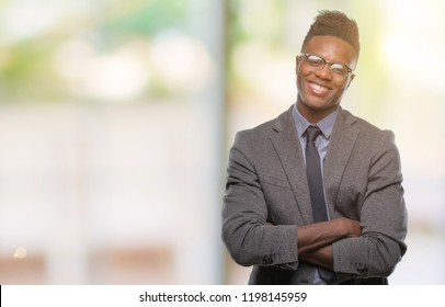 Young african american business man over isolated background happy face smiling with crossed arms looking at the camera. Positive person.