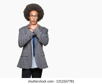 Young african american business man with afro hair wearing glasses shouting and suffocate because painful strangle. Health problem. Asphyxiate and suicide concept.