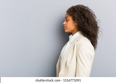 Young african american business woman gazing left, sideways pose.