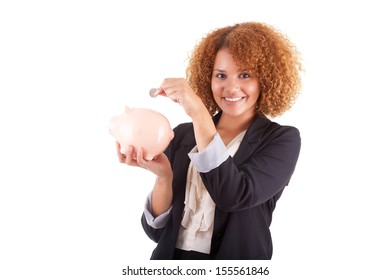 Young african american business woman holding a piggy bank, isolated on white background - African people