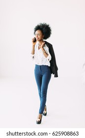 Young african american business woman talking on the phone