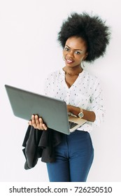Young african american business woman using the laptop