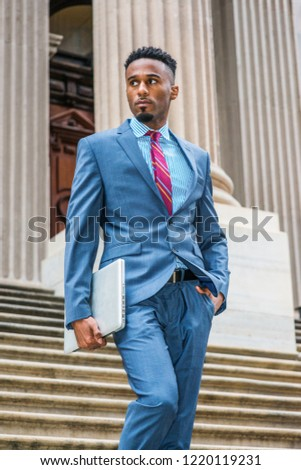 0bf8bdb645 Young African American Businessman with beard working in New York, wearing  dark sky blue suit
