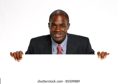 Young African American Businessman Holding a blank sign isolated on a white background