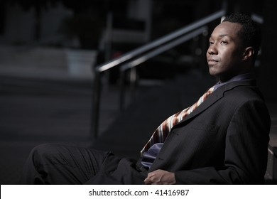 Young African American businessman relaxing after work