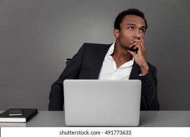 Young African American businessman is working out a plan for his company's growth. Concept of strategic thinking