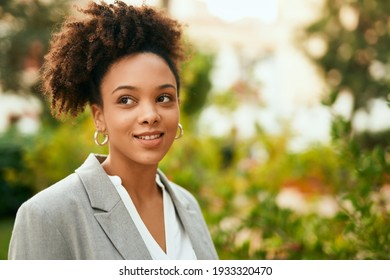 Young african american businesswoman smiling happy standing at the park.