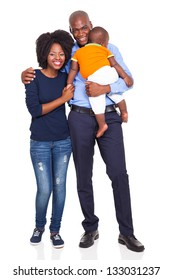 young African American couple with baby standing, isolated on white background