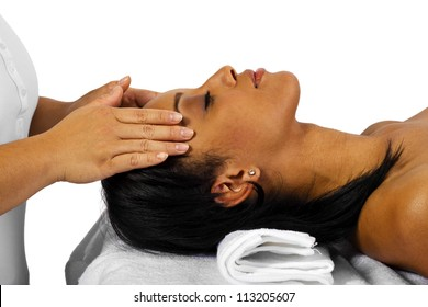Young African American female getting a facial/head massage