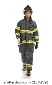Young African American  firefighter standing portrait isolated on white background