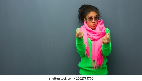 Young african american girl with blue eyes doing a gesture of need