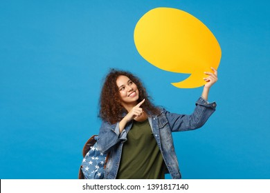 Young african american girl teen student in denim clothes, backpack hold say cloud isolated on blue background studio portrait. Education in high school university college concept. Mock up copy space